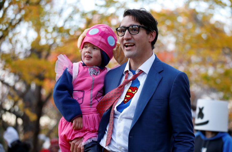 Canada's PM Trudeau carries his son Hadrien while participating in Halloween festivities at Rideau Hall in Ottawa
