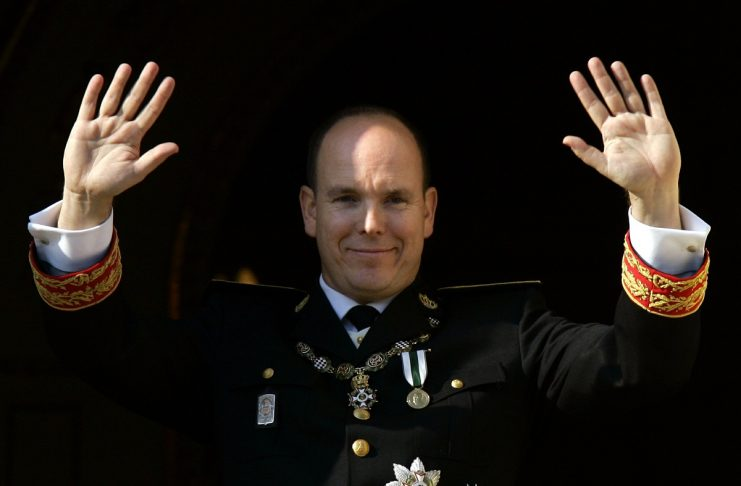 Prince Albert of Monaco waves from the balcony of Monaco palace