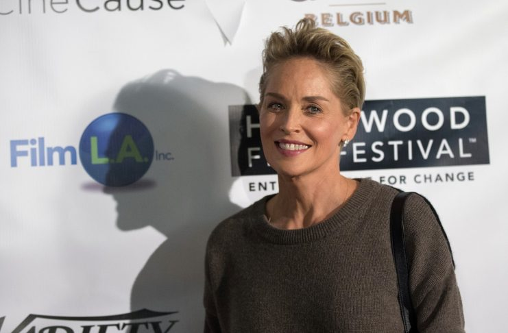 Actress and producer Stone poses at the 18th Annual Hollywood Film Fest in Hollywood