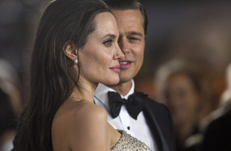"Director and cast member Jolie and her husband and co-star Pitt pose at the premiere of ""By the Sea"" during the opening night of AFI FEST 2015 in Hollywood"