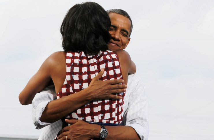 U.S. President Barack Obama hugs the first lady at campaign event in Davenport, Iowa