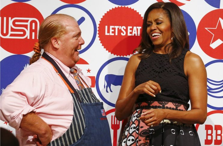 U.S. first lady Obama smiles with American chef Batali at James Beard American Restaurant in Milan