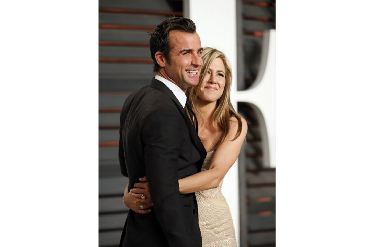 Jennifer Aniston and Justin Theroux arrive at the 2015 Vanity Fair Oscar Party in Beverly Hills