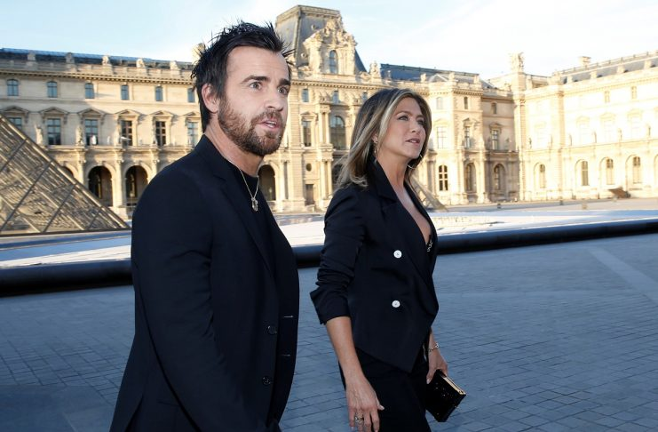 Actress Jennifer Aniston and Justin Theroux arrives to attend a dinner organized by French luxury group Louis Vuitton for the launching of new leather accessories in Paris
