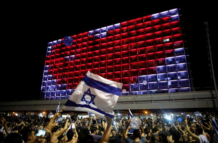 Israeli fans celebrate at Rabin square in Tel Aviv Israel, after Israeli singer Netta Barzilai won the Grand Final of Eurovision Song Contest 2018