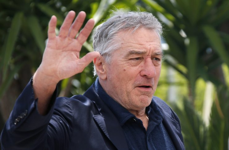 "Cast member Robert De Niro waves as he arrives at a photocall for the film ""Hands of stone"" out of competition at the 69th Cannes Film Festival in Cannes"
