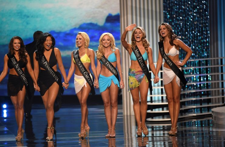 Contestants await the results after competing in the swimsuit component of the 97th Miss America Competition